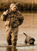 Derrick hunting with gun dog